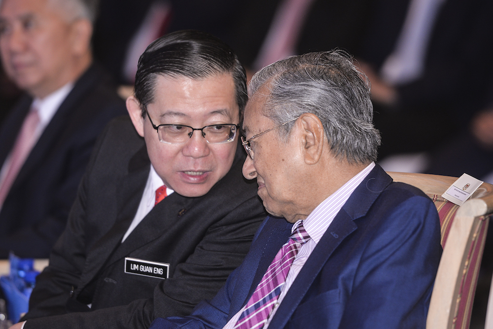 Dr Mahathir and Lim met for talks at 8.45am in Putrajaya today. — Picture by Shafwan Zaidon