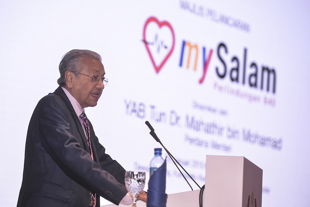 Tun Dr Mahathir Mohamad speaks at the launch of mySalam in Putrajaya January 24, 2019. — Picture by Shafwan Zaidon