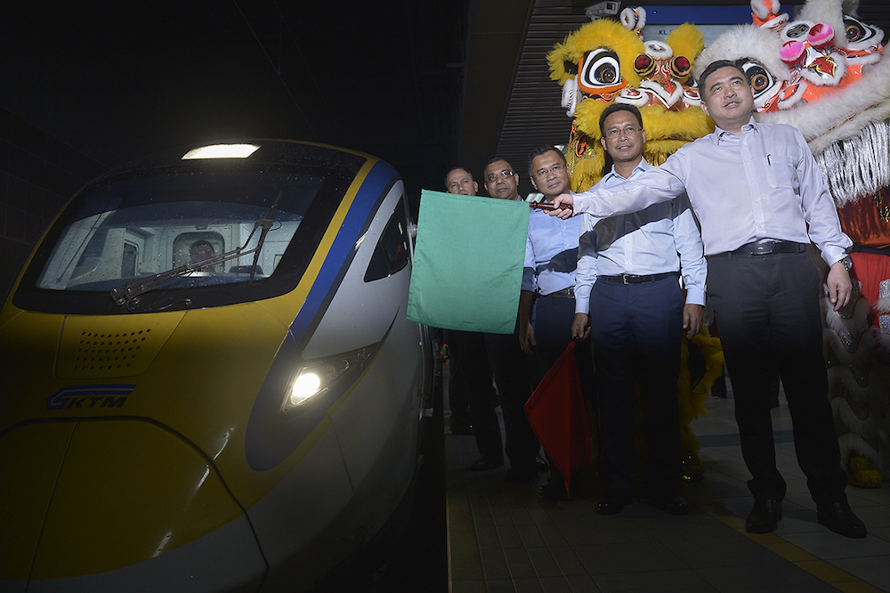 Transport Minister Anthony Loke flags off KTMB's ETS Train at KL Sentral in Kuala Lumpur January 31, 2018. — Picture by Mukhriz Hazim