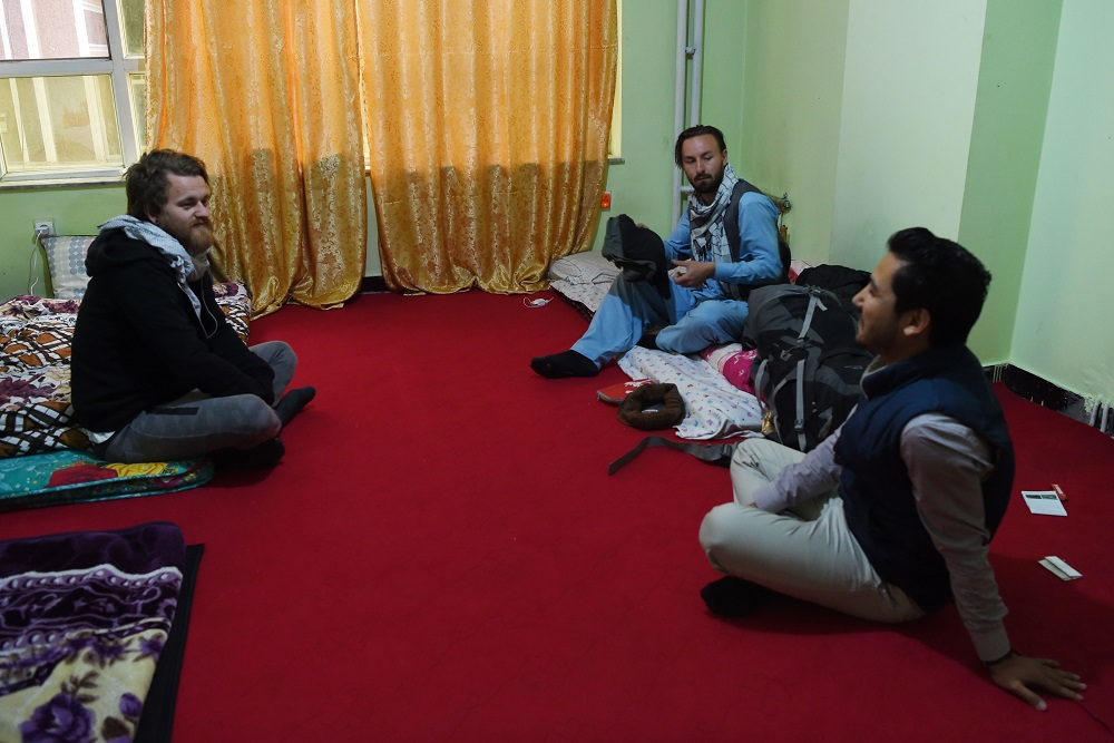 In this photo taken on November 11, 2018, Afghan Couchsurfing host Naser Majidi (right), 27, talks with his guests Norwegian tourist Jorn Bjorn Augestad (left), 29, and Dutch tourist Ciaran Barr, 24, at a house in Kabul. — AFP pic