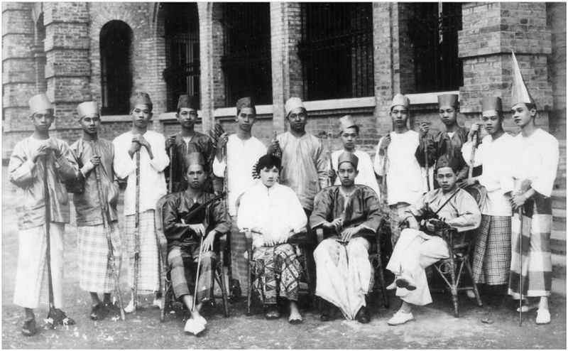 A 'boria' party in 1920. — Picture courtesy of the Penang State Museum