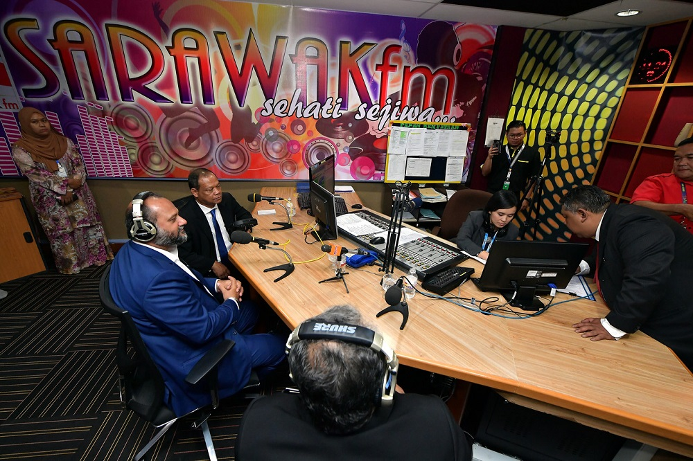 Communications and Multimedia Minister Gobind Singh Deo (left) during an interview at the SARAWAKfm radio station in Kuching January 14, 2019. — Bernama pic