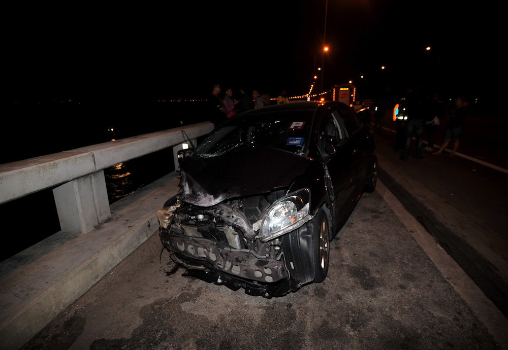 A wrecked car is seen at KM4 of the Penang Bridge in the early hours of January 20, 2019. — Bernama pic