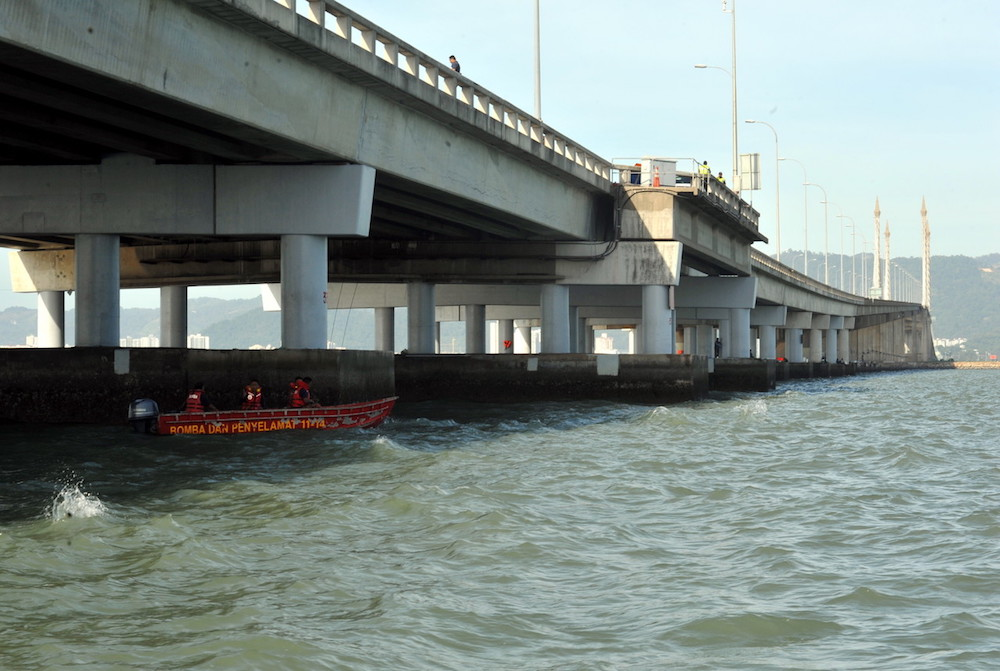 File picture of Fire and Rescue Department personnel conducting a search and rescue operation in the waters below Penang Bridge January 20, 2019. — Bernama pic