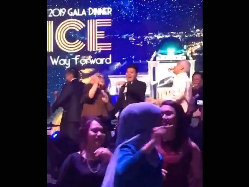 Lawyer Siti Kasim (2nd right, on stage) and Attorney General Tommy Thomas (right) are seen dancing during the Opening of the Legal Year 2019. — Picture via Twitter/Rimau XI