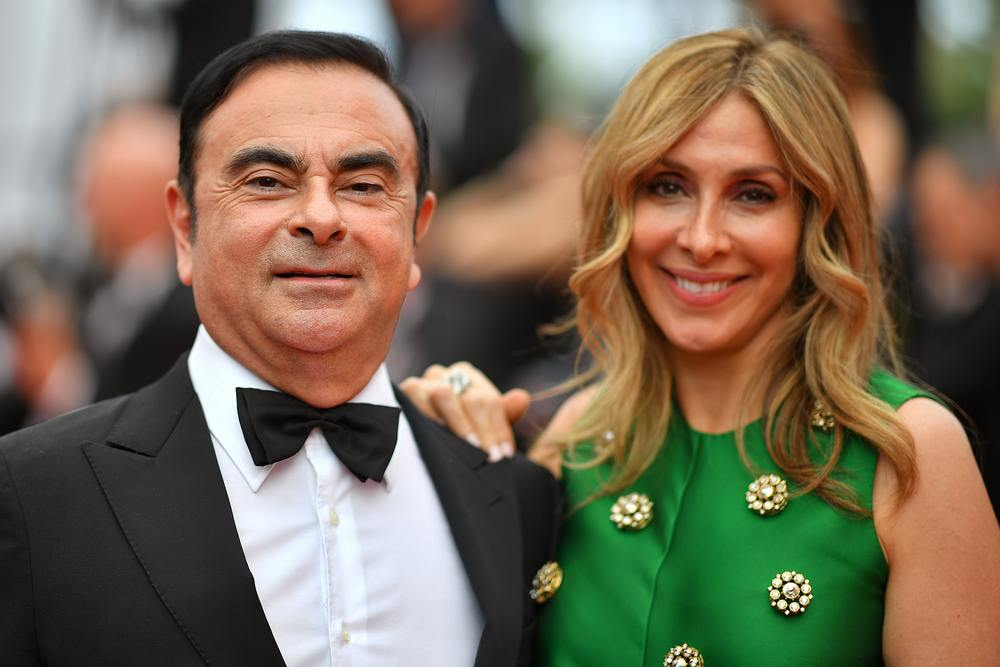 File picture shows Carlos Ghosn (left) and his wife Carole Ghosn arriving for the screening of the film 'L'Amant Double' (Amant Double) at the Cannes Film Festival, France May 26, 2017. — AFP pic