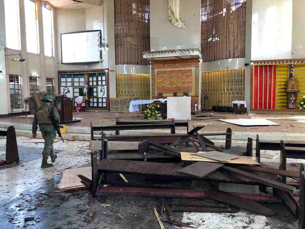 A Philippine Army member walks inside a church after a bombing attack in Jolo, Sulu province January 27, 2019. — Armed Forces of the Philippines handout via Reuters