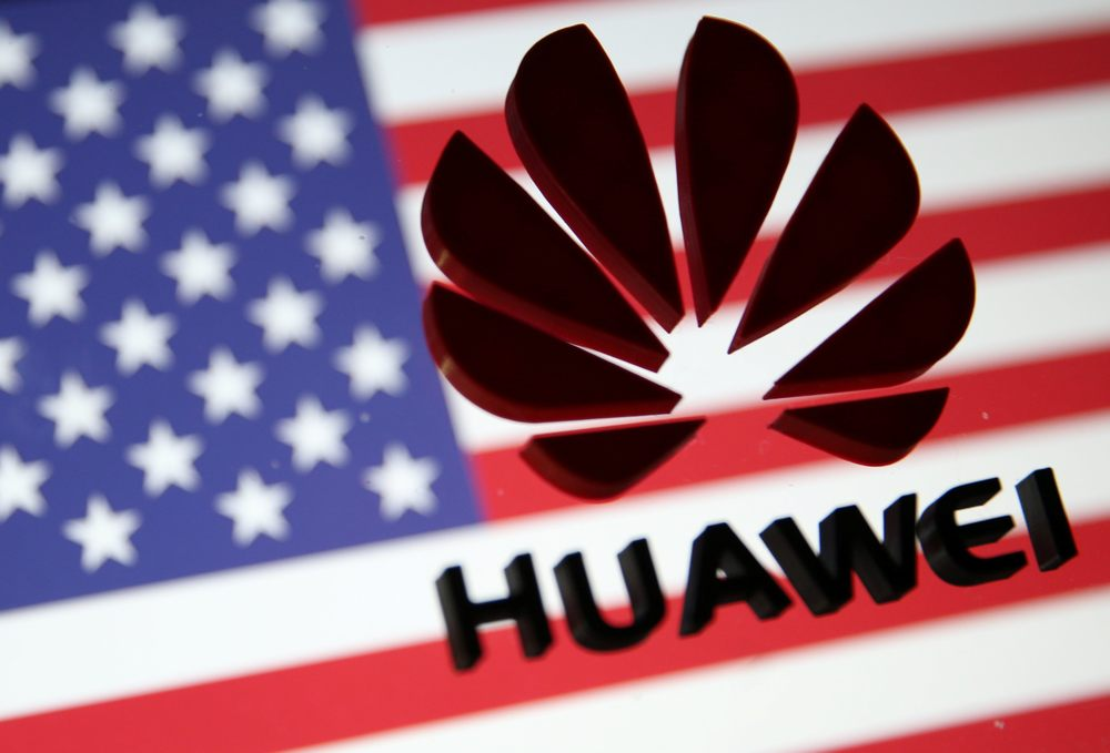 A 3D printed Huawei logo is placed on glass above displayed US flag in this illustration taken January 29, 2019. — Reuters pic
