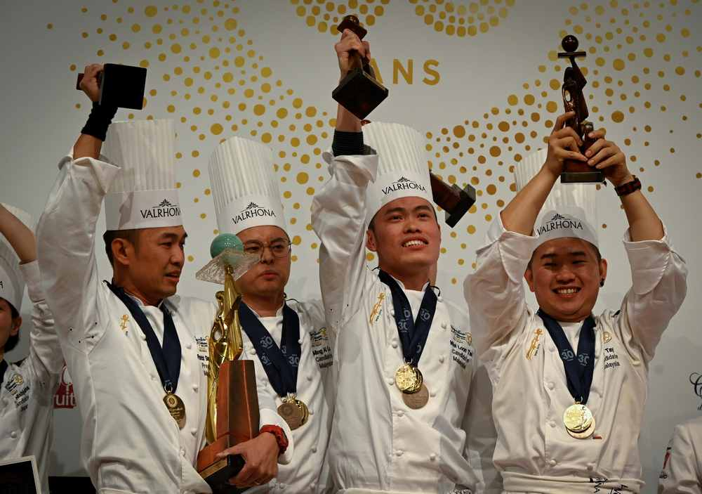 Members of the Malaysian team (from left) Situ Chi Yin, Ming Ai Lol, Wei Loon Tan and Otto Tay celebrate with their trophy after winning the World Pastry Cup final January 28, 2019 in Chassieu, outside Lyon. — AFP pic