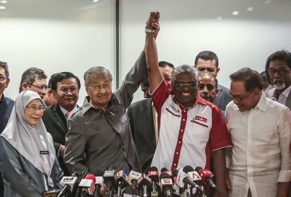 Tun Dr Mahathir Mohamad and Cameron Highlands candidate from DAP M. Manogaran during a press conference at Yayasan Al Bukhary in Kuala Lumpur January 4, 2019. ― Picture by Firdaus Latif