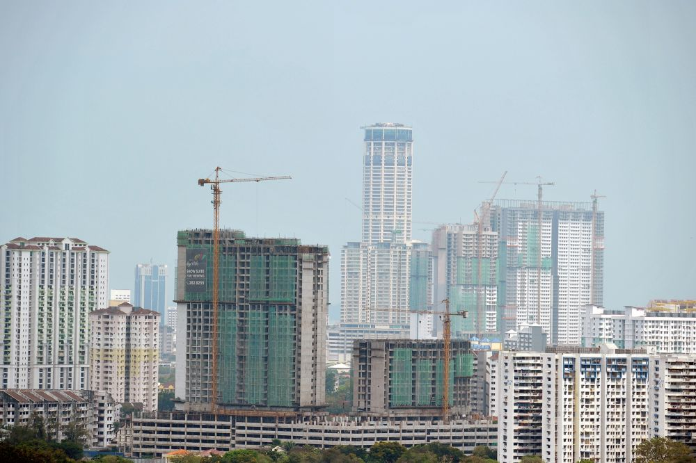 Housing and Local Government Minister Zuraida Kamaruddin said the ministry also planned to discuss with all state governments to review the property sales price and terms for foreign buyers in order to get the overhang units sold. — Picture by KE Ooi