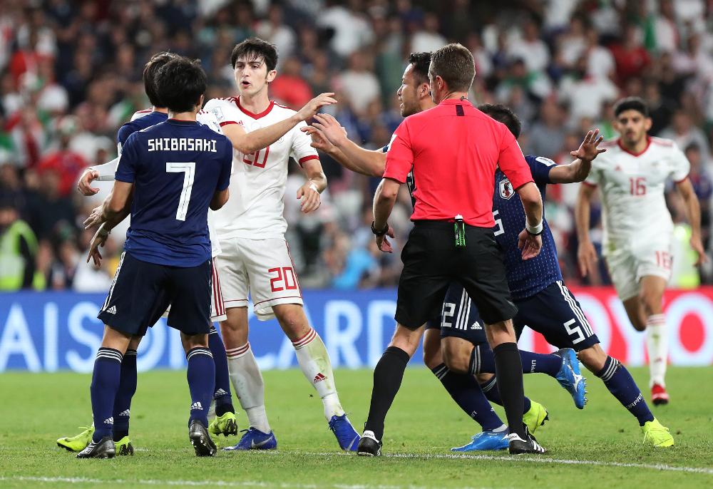Iran's Sardar Azmoun clashes with Japan's Gaku Shibasaki during their AFC Asian Cup Semi-Final at the Hazza Bin Zayed Stadium, Al Ain, United Arab Emirates January 28, 2019. — Reuters pic
