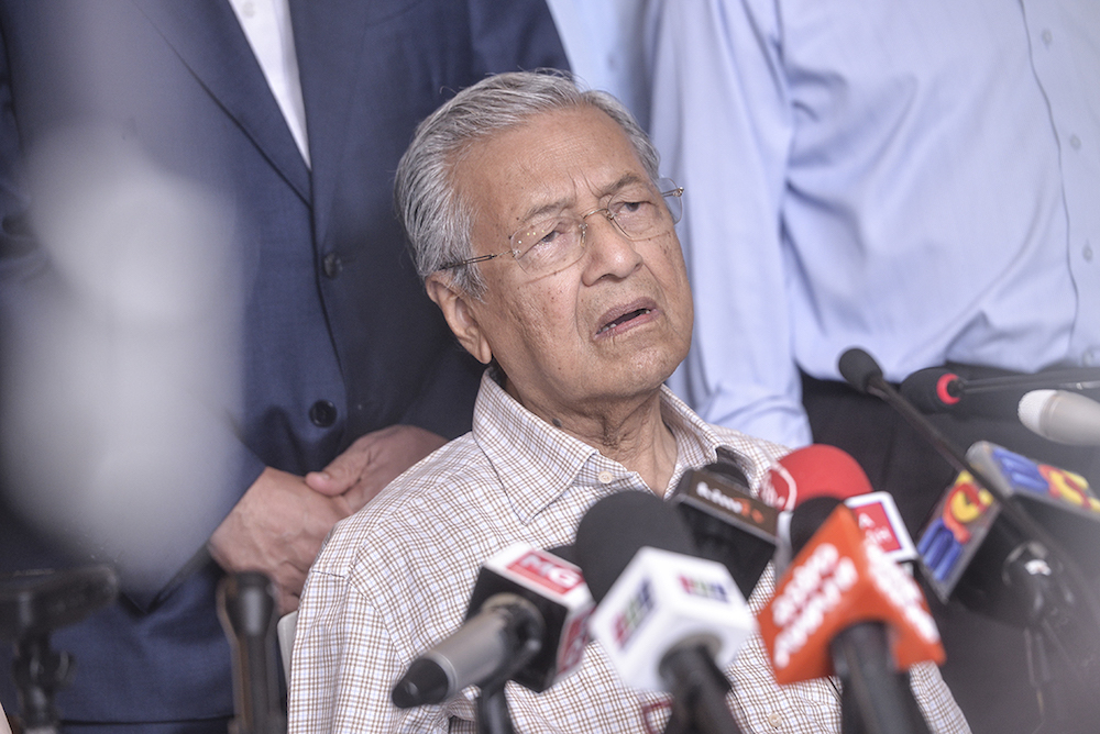 Tun Dr Mahathir Mohamad speaks to reporters after chairing the Pakatan Harapan presidential council meeting in Putrajaya February 1, 2019. — Picture by Shafwan Zaidon