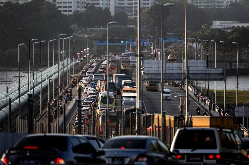 About 60,000 foreign vehicles enter Singapore daily and the majority of foreign motorists are law-abiding. — TODAY pic