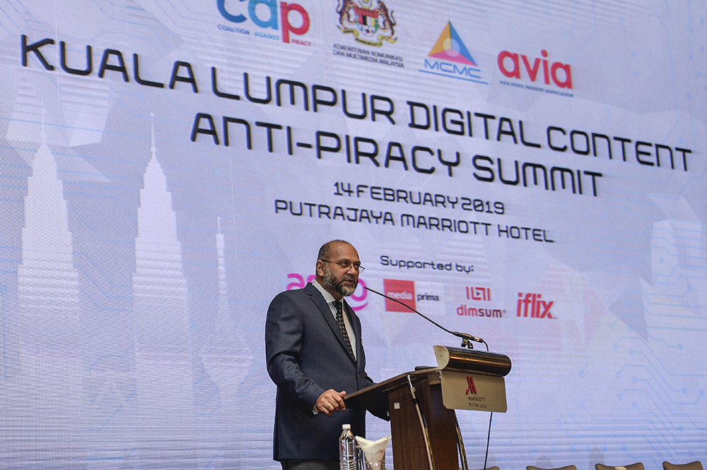 Communications and Multimedia Minister Gobind Singh Deo gives a speech during the Kuala Lumpur Digital Content Anti-Piracy Summit in Putrajaya February 14, 2019. — Picture by Miera Zulyana