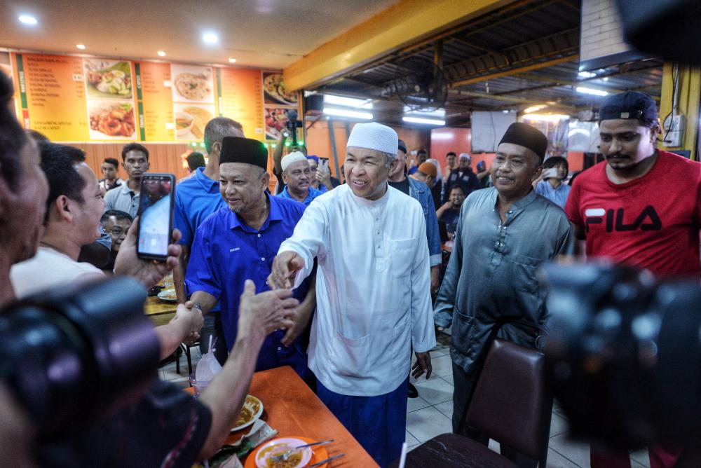 Datuk Seri Ahmad Zahid Hamidi and BN Semenyih candidate Zakaria Hanafi are seen during a visit to Semenyih February 19, 2019. — Picture by Shafwan Zaidon