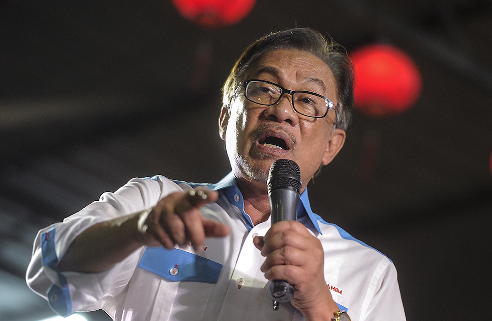 PKR president Datuk Seri Anwar Ibrahim describes the attack as a 'black tragedy facing humanity and universal peace.' — Picture by Shafwan Zaidon