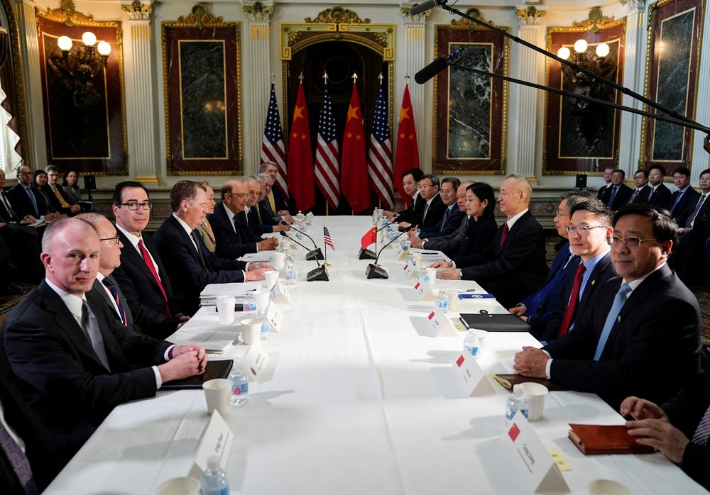 US Trade Representative Robert Lighthizer (fourth left), Treasury Secretary Steven Mnuchin, Commerce Secretary Wilbur Ross, White House economic adviser Larry Kudlow and White House trade adviser Peter Navarro pose for a photograph with China's Vice Premier Liu He (fourth right), Chinese vice ministers and senior officials before the start of US-China trade talks at the White House, February 21, 2019. — Reuters pic