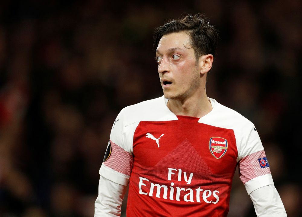 Mesut Ozil did not feature towards the end of last season and was not named in Arsenal's matchday squad for the first three games of the new campaign. ― Reuters pic