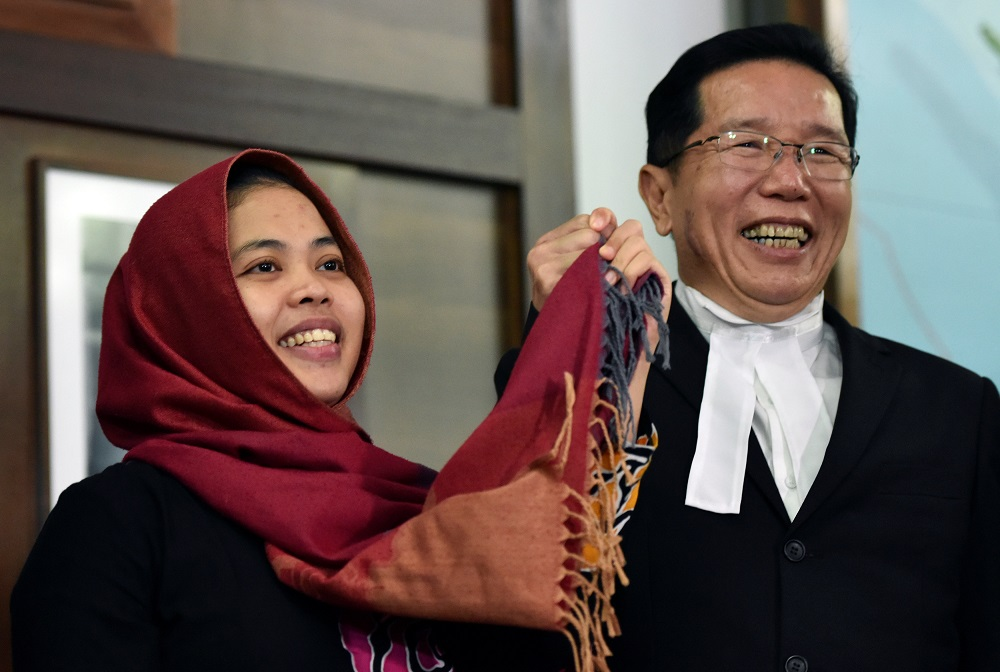 Indonesian Siti Aisyah (left), accused in the 2017 killing of Kim Jong-nam, and who was freed by the High Court, attends a news conference at the Indonesian embassy in Kuala Lumpur March 11, 2019. — Reuters pic