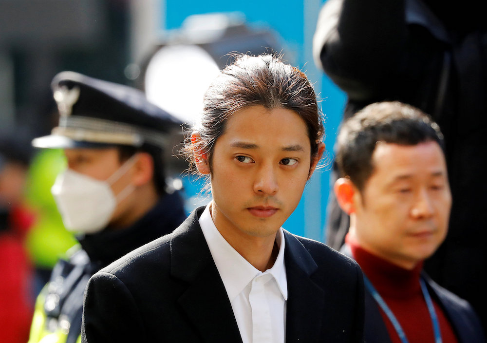 South Korean singer Jung Joon-young arrives for questioning on accusations of illicitly taping and sharing sex videos on social media, at the Seoul Metropolitan Police Agency in Seoul March 14, 2019. — Reuters pic