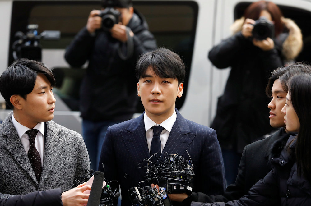 Seungri arrives to be questioned over a sex bribery case at the Seoul Metropolitan Police Agency in Seoul March 14, 2019. — Reuters pic