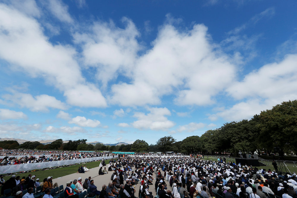 People attend the Friday prayers at Hagley Park outside Al-Noor mosque in Christchurch, New Zealand March 22, 2019. — Reuters pic