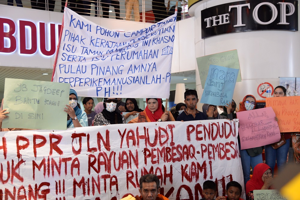 Protesters gather at the Komtar building during a demonstration against the eviction from their Taman Manggis PPR homes in George Town March 6, 2019. — Picture by Steven Ooi KE
