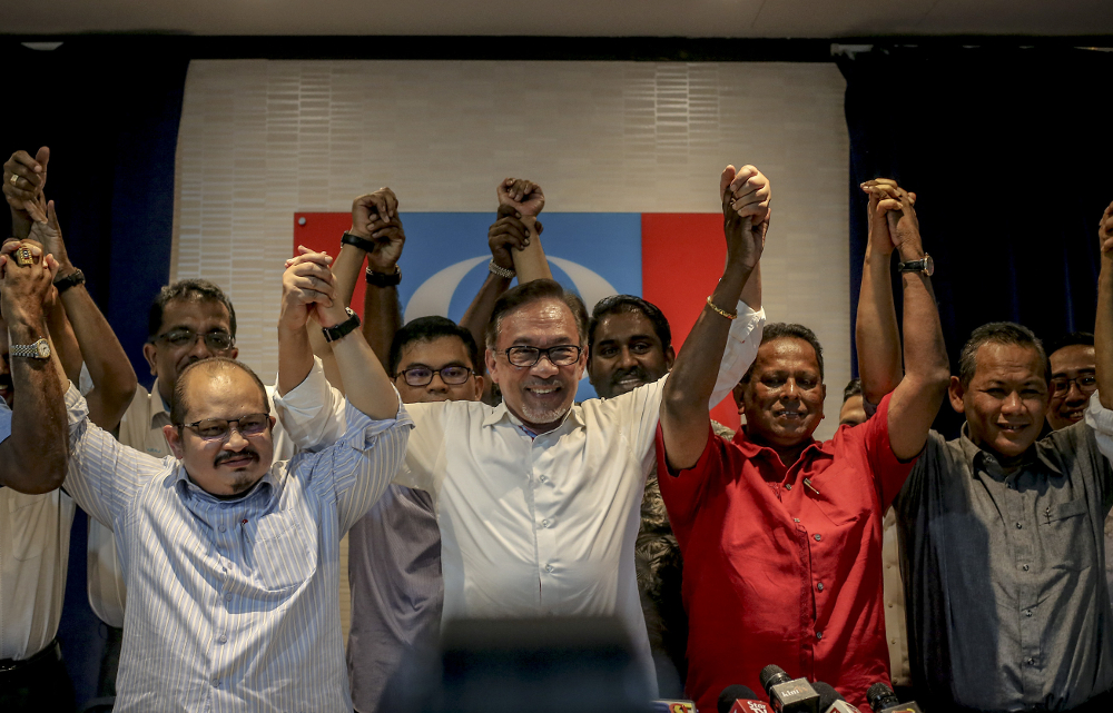 PKR president Datuk Seri Anwar Ibrahim with PKR candidate Dr Streram Sinnasamy for Rantau by-election (2nd right) during a press conference in Petaling Jaya March 11, 2019. — Picture by Firdaus Latif