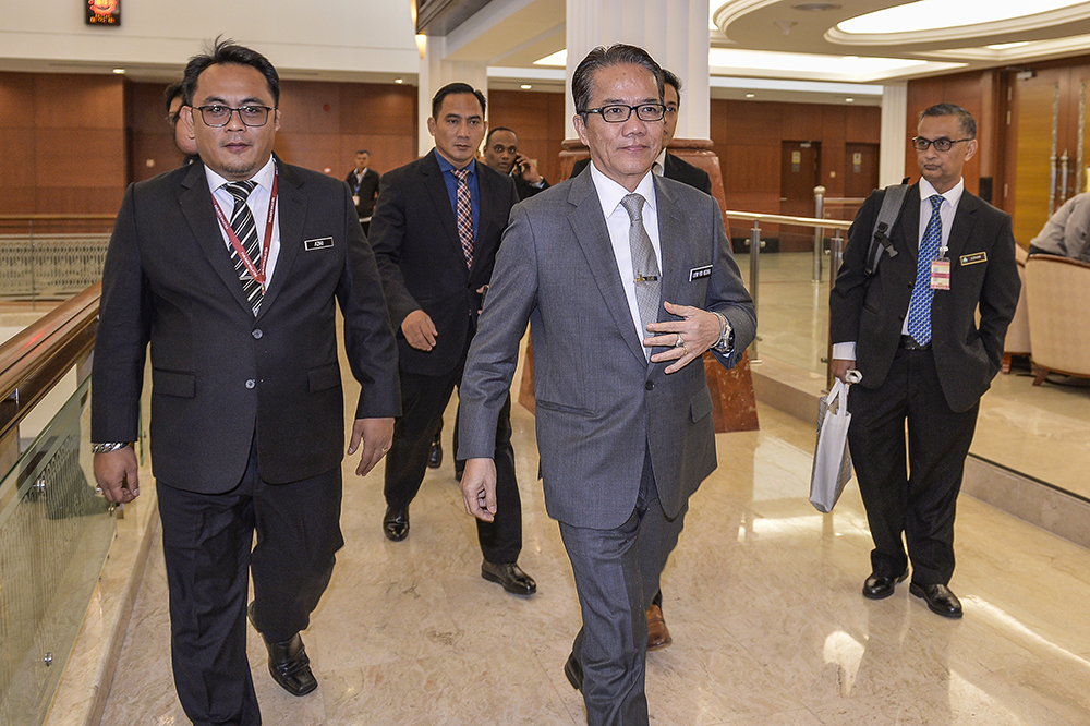 Legal Affairs Minister Datuk Liew Vui Keong (centre) at Parliament March 19, 2019. — Picture by Miera Zulyana