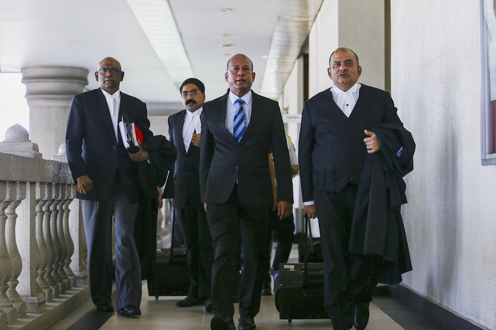 Former Asian International Centre for Arbitration's (AIAC) director Datuk Sundra Rajoo Nadarajah (centre) leaves the Sessions Court in Kuala Lumpur March 26, 2019. — Picture by Hari Anggara