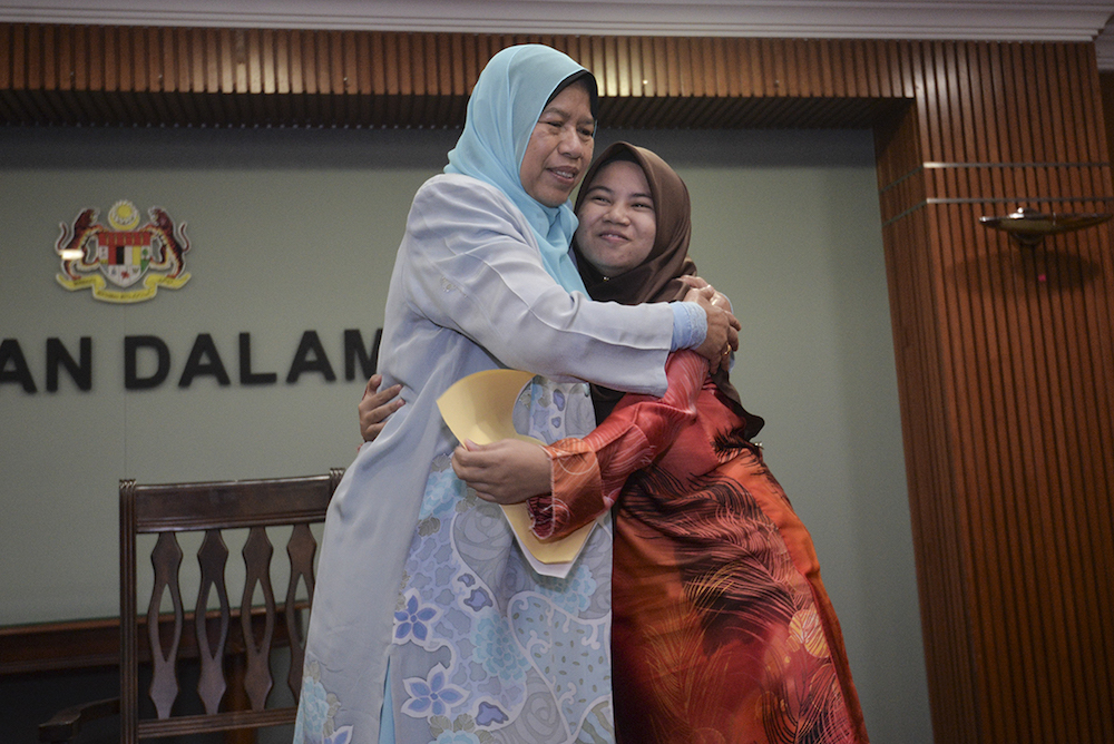 Housing and Local Government Minister Zuraida Kamaruddin hugs her ward Roisah Abdullah after the latter received her national citizenship letter in Putrajaya March 28, 2019. — Picture by Shafwan Zaidon