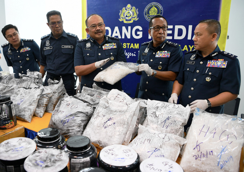 Customs assistant director-general (enforcement) Datuk Abdul Latif Abdul Kadir is pictured with part of the syabu haul during a press conference in Kota Kinabalu March 6, 2019. — Bernama pic