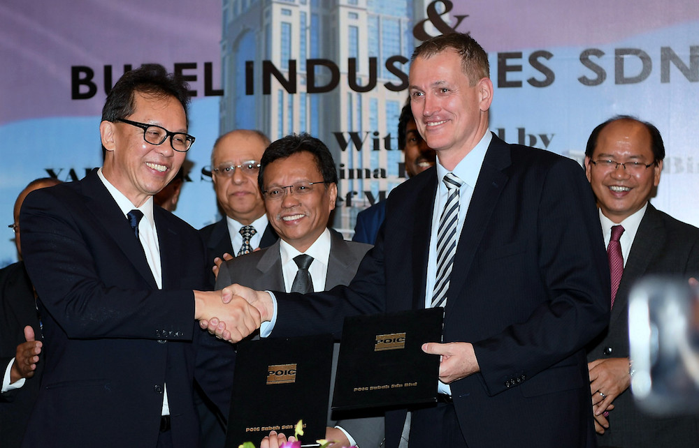 Chief Minister Datuk Seri Mohd Shafie Apdal witnesses the signing ceremony between POC Sabah CEO Datuk Pang Teck Wai and Burel Industries executive chairman Per N. Brandtzag in Kota Kinabalu March 6, 2019. — Bernama pic
