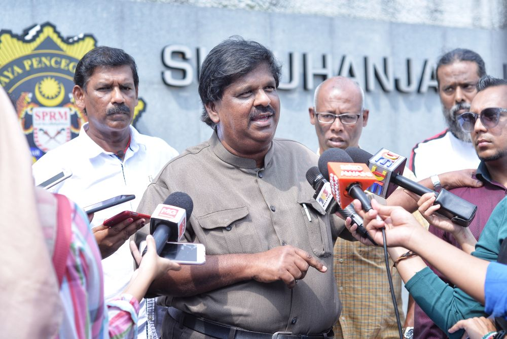Sungai Siput MIC division chief M. Lokanathan speaks to reporters at the Malaysia Anti-Corruption Commission headquarters in Putrajaya March 8, 2019. ― Picture by Shafwan Zaidon
