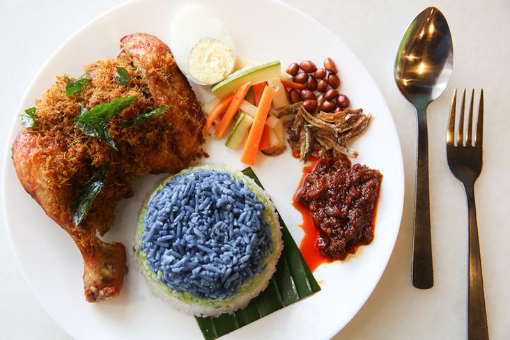 Their nasi lemak '3 Rasa'combines colourful layers for their coconut rice with a juicy ayam berempah goreng, acar and sambal