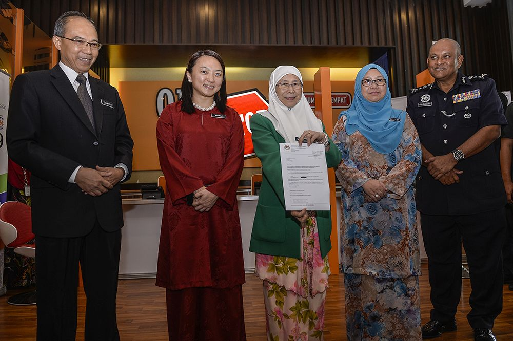 Minister of Woman, Family and Community Development Datuk Seri Dr Wan Azizah Wan Ismail (centre) launches the child sex offenders registry in Putrajaya March 26, 2019. — Picture by Miera Zulyana
