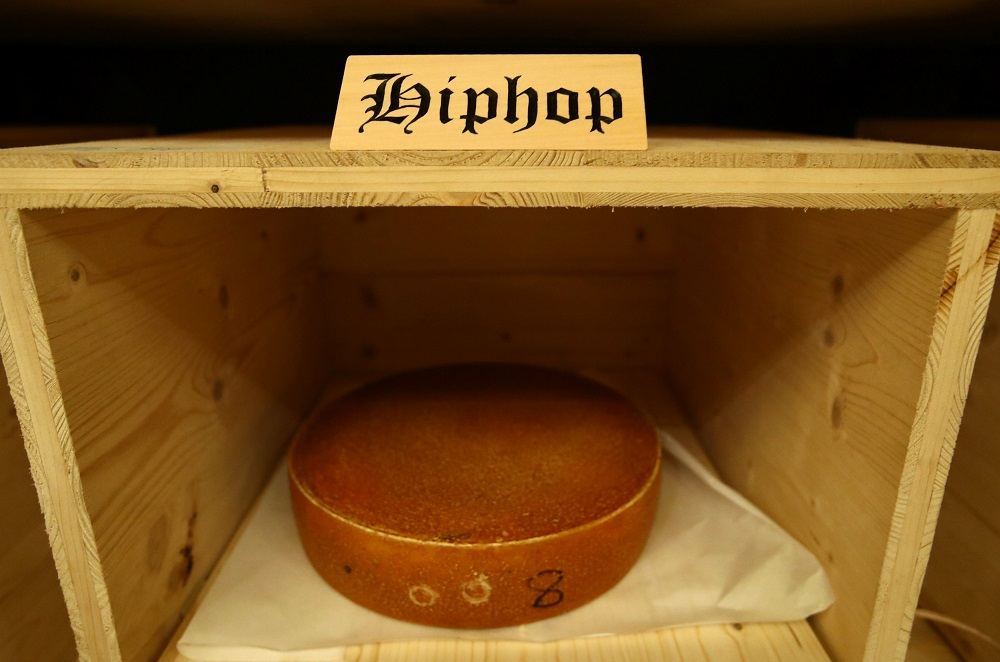 A wheel of cheese is pictured in the K3 cellar during the experiment to 'insonify' cheese with different types of music, in this case Hiphop, by the University of the Arts during a media presentation in Burgdorf, Switzerland March 13, 2019. — Reuters pic