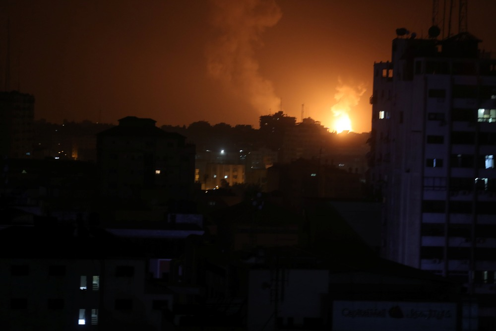 Smoke and flame are seen during an Israeli air strike in Gaza March 15, 2019. — Reuters pic
