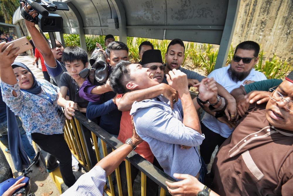 Students protest Datuk Seri Najib Razak's meet-and-greet session in front of Restoran Amjal near Universiti Malaya in Kuala Lumpur March 22, 2019. — Picture by Shafwan Zaidon