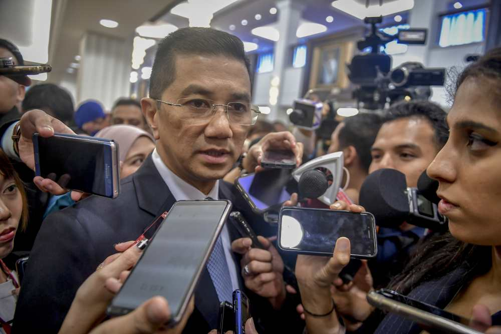 File picture shows Economic Affairs Minister Datuk Seri Mohamed Azmin Ali speaking to reporters at Parliament in Kuala Lumpur March 12, 2019. ― Picture by Firdaus Latif