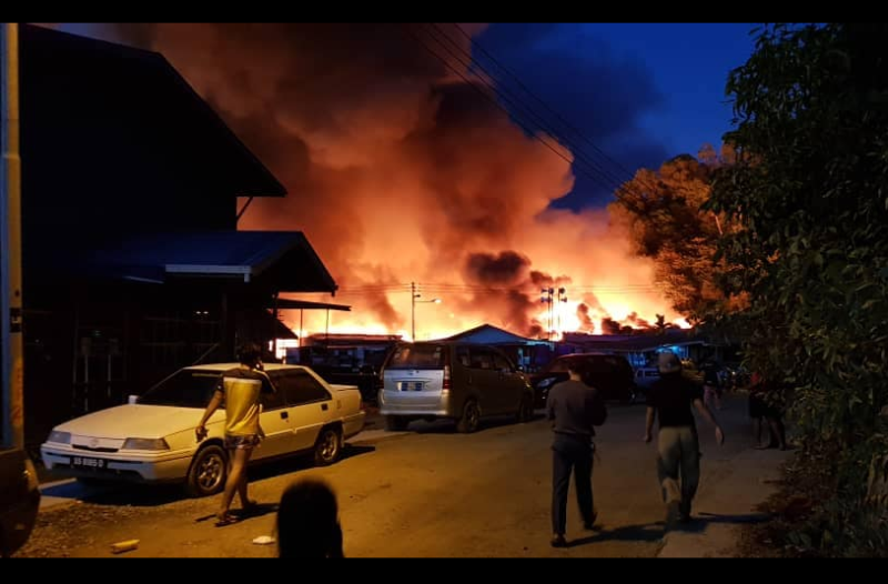 A fire razed some 30 houses in Sandakan early this morning. — Picture via Facebook