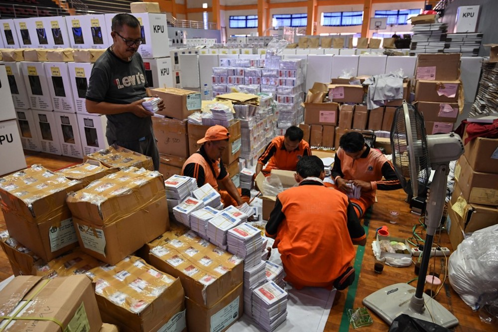 Officials prepare ballot boxes and other voting materials in Jakarta April 11, 2019, ahead of presidential and legislative elections. — AFP pic