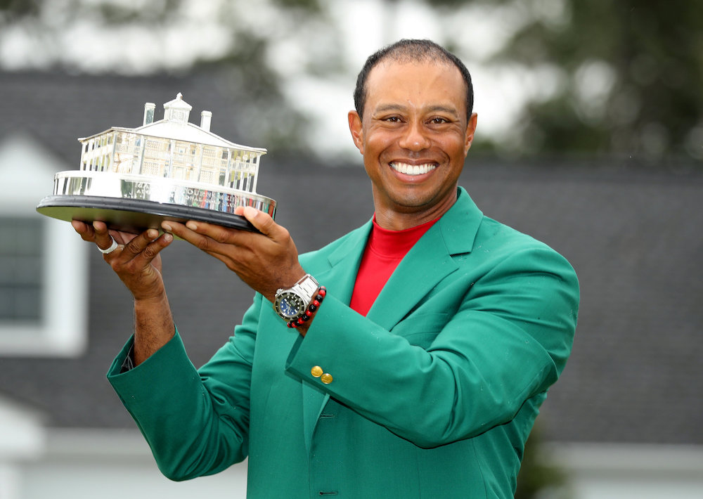 Tiger Woods of the US celebrates with his green jacket and trophy after winning the 2019 Masters in Augusta April 14, 2019. — Reuters pic
