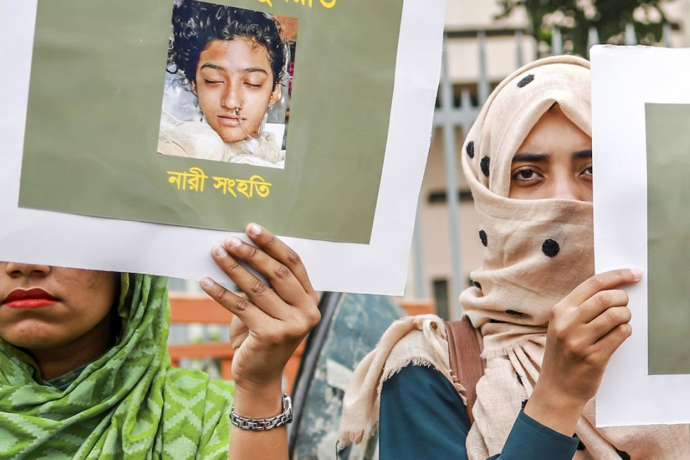In this photo taken April 12, 2019 Bangladeshi women hold placards and photographs of schoolgirl Nusrat Jahan Rafi at a protest in Dhaka, following her murder by being set on fire after she had reported a sexual assault. — AFP pic