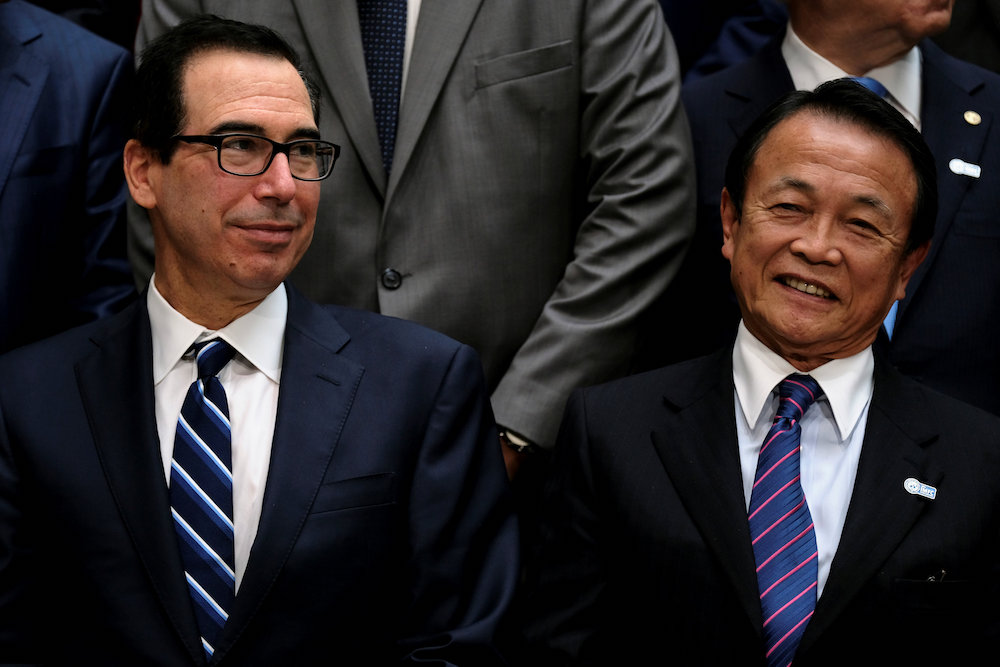 US Treasury Secretary Steven Mnuchin and Japanese Finance Minister Taro Aso attend the IMF and World Bank's 2019 Annual Spring Meetings, in Washington, April 13, 2019. — Reuters pic