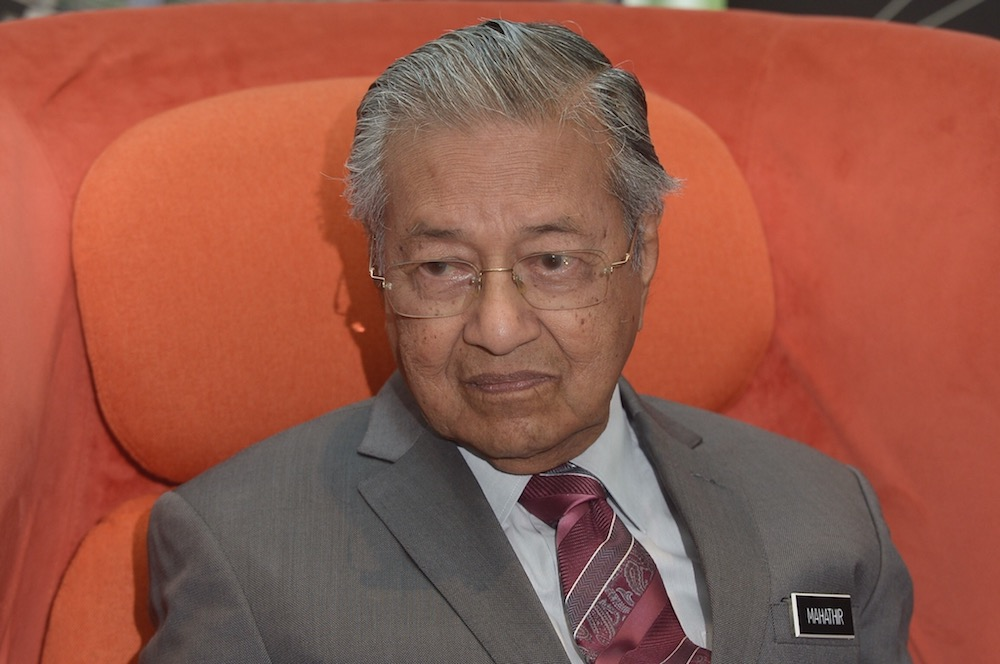 Dr Mahathir reiterated the importance of respecting the Constitution and abiding by it, for failure in doing so would negate the rule of law. — Picture by Mukhriz Hazim