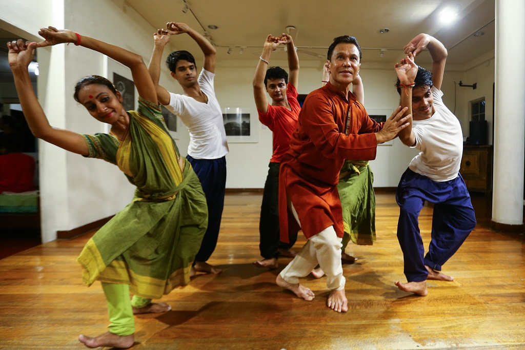 Datuk Ramli Ibrahim (second from right) rehearses with dancers for the upcoming 'Odissi on High' performance.