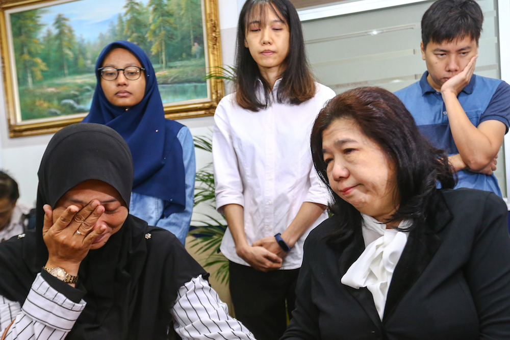 Norhayati Mohd Arifin and Susanna Liew attend the announcement of Suhakam's public inquiry findings into the disappearances of pastor Raymond Koh and Amri Che Mat in Kuala Lumpur April 3, 2019. — Picture by Hari Anggara