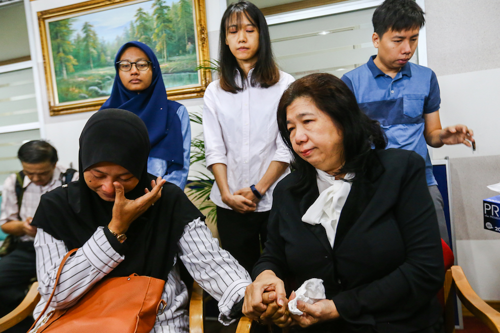 The wives of the missing activists, Norhayati Mohd Arifin and Susanna Liew, attend the announcement of Suhakam's public inquiry findings into the disappearances of pastor Raymond Koh and Amri Che Mat in Kuala Lumpur April 3, 2019. — Picture by Hari Anggara